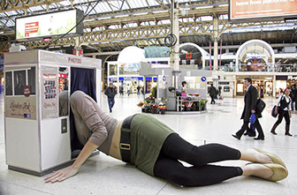 A giant female figure was spraweled across the concourse at Victoria Station