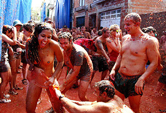 ACTION FROM THE ANUAL TOMATINA FESTIVAL IN BUNOL
