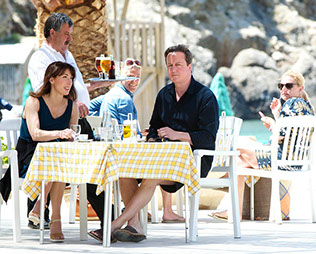 The Prime Minister of the United Kingdom, David Cameron and his wife