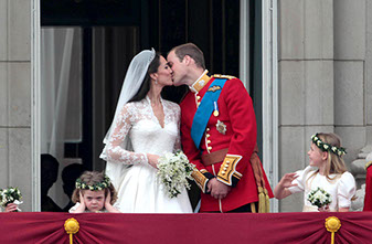 Prince William and Kate Middleton kiss on the balcony of Buckingham Palace after their wedding at Westminster Abbey